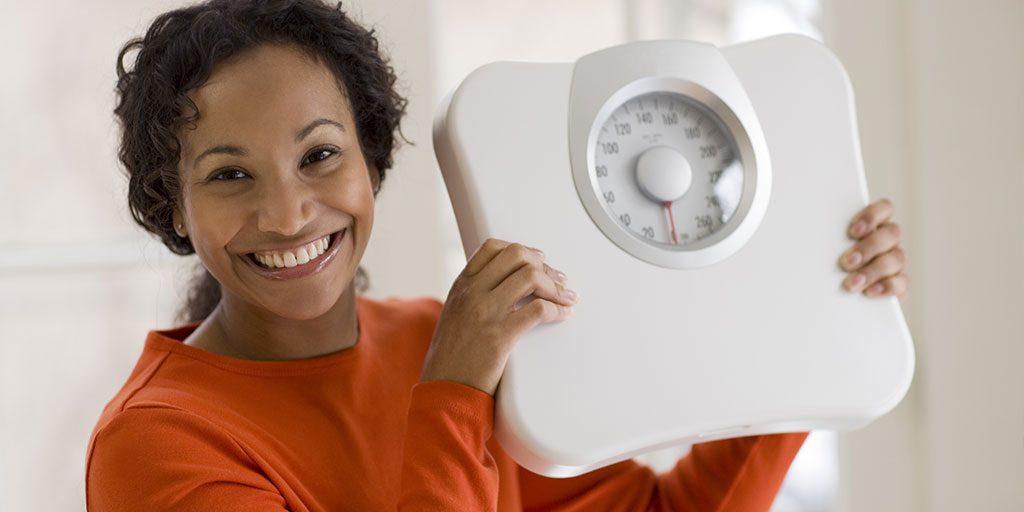 a woman getting over her weight loss plateau