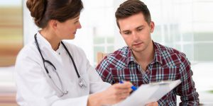 a doctor giving a patient std testing results