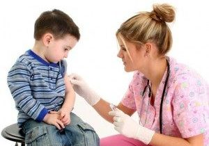 Nurse giving child the flu shot